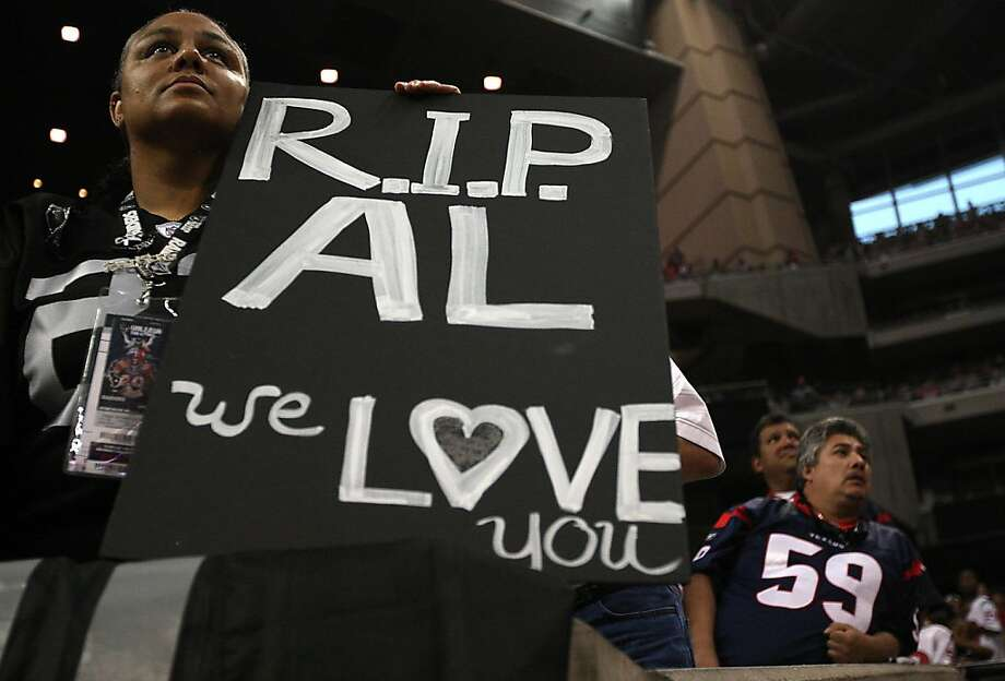 "Rachel Brown, of Oakland, California, holds up her ""R.I.P. Al"" poster in honor of Al Davis' passing in the fourth quarter of an NFL football game at Reliant Stadium, Sunday, Oct. 9, 2011, in Houston. Raiders won the game 25-20.  ( Karen Warren / Houston Chronicle ) Photo: Karen Warren, Houston Chronicle"
