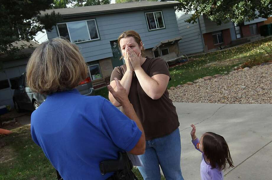 MILIKEN, CO - OCTOBER 05:  Brandie Barbiere (C) reacts as Weld County sheriff's deputy Mary Schwartz (L) arrives to evict her and her family from their home on October 5, 2011 in Miliken, Colorado. Barbiere said she had stopped making the mortgage payments 11 months before, after she lost more than half her home child care business due to the economy. The Barbiere family's possessions were removed to the front yard by an eviction team and the door locks changed. A nationwide glut of foreclosed homes is expected to depress U.S. housing values for years.  (Photo by John Moore/Getty Images) Photo: John Moore, Getty Images