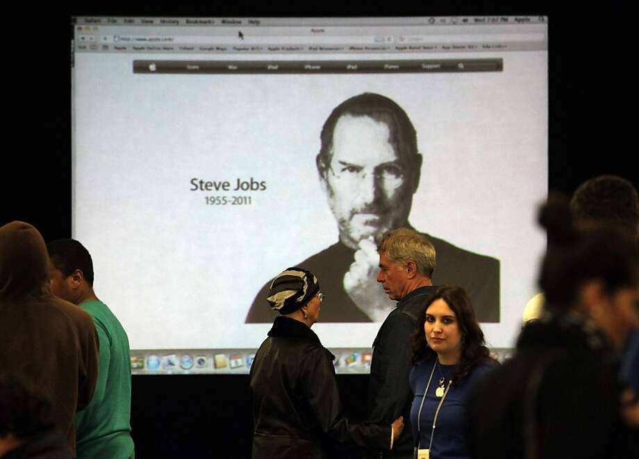 An image of Steve Jobs is shown on a screen at the Apple Store in Santa Monica, Calif., Wednesday, Oct. 5, 2011. Jobs, the Apple founder and former CEO who invented and masterfully marketed ever-sleeker gadgets that transformed everyday technology, from the personal computer to the iPod and iPhone, has died. He was 56. (AP Photo/Jae C. Hong) Photo: Jae C. Hong, AP