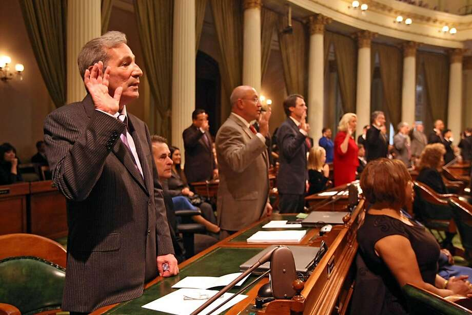 Tom Ammiano of San Francisco (D) who was newly elected to California Assembly took the oath of office in the Assembly Chambers at the State Capital Building in Sacramento, Calif., on December 1, 2008. Ran on: 04-12-2009 Tom Ammiano (left) took the oath of office in the Assembly Chambers on Dec. 1. Photo: Frederic Larson, The Chronicle