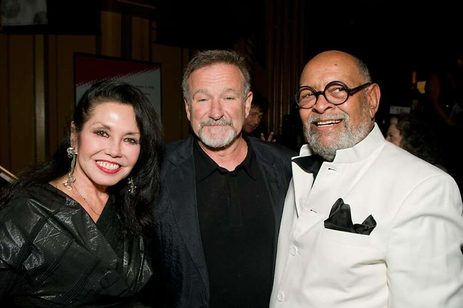 Janice Mirikitani (left) with actor Robin Williams and her husband, the Rev. Cecil Williams at Glide's Holiday fundraiser. December 2010. By Alain McLaughlin.     Ran on: 12-08-2010 Janice Mirikitani (left), Robin Williams and the Rev. Cecil Williams at Glide's fundraiser. Photo: Alain McLaughlin, Special To The Chronicle