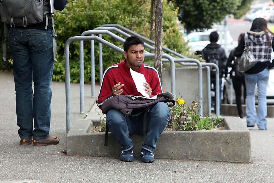Abdulla Naim, 24 years old, tryng to get permission to enter a class that is full at City College of San Francisco in Calif., on Monday, August 22, 2011.   Ran on: 08-23-2011 Abdulla Naim, 24, is trying to enter a full class at City College of San Francisco. Because of cuts, students are struggling to enroll in classes they need to graduate on time. Ran on: 08-23-2011 Abdulla Naim, 24, is trying to enter a full class at City College of San Francisco. Because of cuts, students are struggling to enroll in classes they need to graduate on time. Photo: Liz Hafalia, The Chronicle