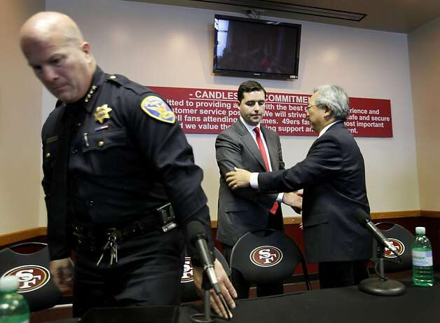 After the press conference, San Francisco Police Chief Greg Suhr (left) rose from the table, while Mayor Ed Lee (right) spoke with 49er President Jed York. A press briefing was held at Candlestick Park Monday August 22, 2011 to discuss the fan violence that erupted after the 49er-Raider game Saturday night. Photo: Brant Ward, The Chronicle