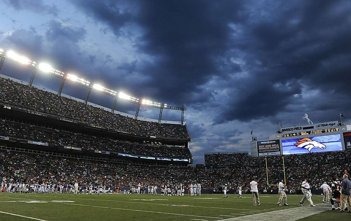 Storm clouds move in over Sports Authority Field at Mile High Stadium in the second quarter of a preseason NFL football game between the Buffalo Bills and Denver Broncos, Saturday, Aug. 20, 2011, in Denver. (AP Photo/Chris Schneider)