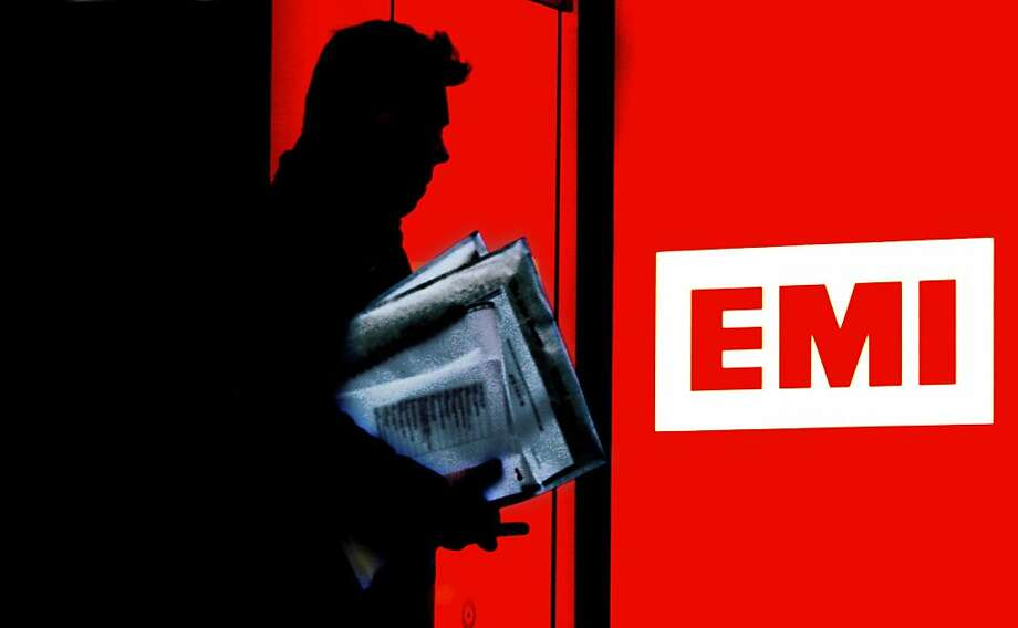 (FILES) -- A file photo taken on Janaury 12, 2007 shows a man silhouetted as he leaves an EMI Record company building in London. Universal Music Group and its parent company French giant Vivendi will buy British music label EMI from US bank Citigroup for £1.2 billion (1.4 billion euros, $1.9 billion), Vivendi said on November 11, 2011. EMI, home to a galaxy of stars including The Beatles, Coldplay and US pop starlet Katy Perry,  was seized by main creditor Citigroup in February from its private equity owners.    AFP PHOTO / CARL DE SOUZA (Photo credit should read CARL DE SOUZA/AFP/Getty Images) Photo: Carl De Souza, AFP/Getty Images