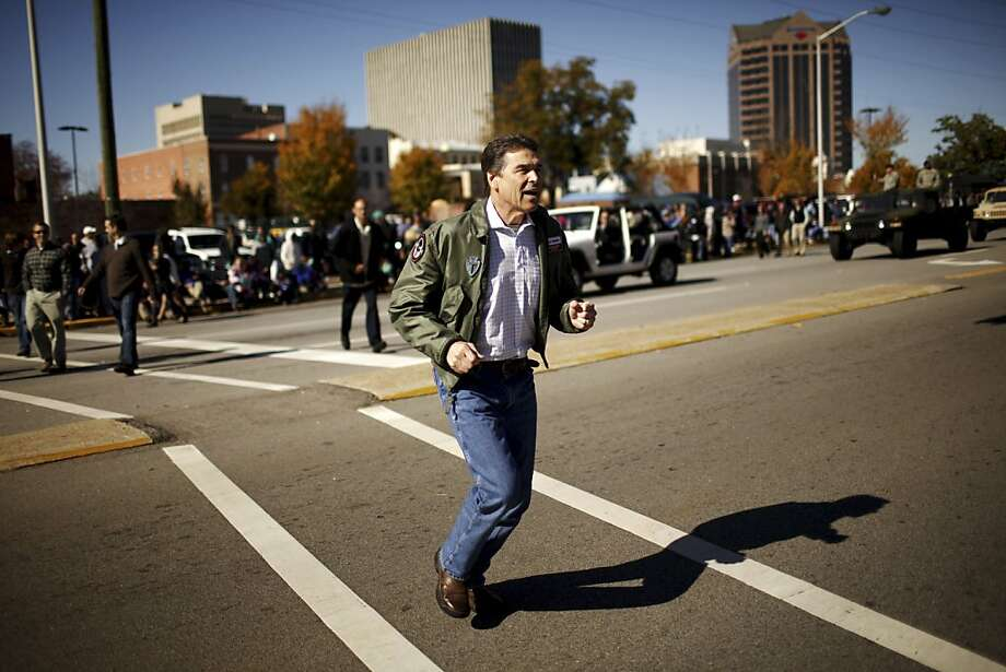 Texas Gov. Rick Perry, a candidate for the Republican presidential nomination, during the 33rd annual Veterans Day Parade and Memorial Service in Columbia, S.C., Nov. 11, 2011. Perry and Rep. Michele Bachmann (R-Minn.), another Republican candidate for the Republican presidential nomination, attended the city's parade today. (Travis Dove/The New York Times) Ran on: 11-12-2011 Texas Gov. Rick Perry is trying to keep his campaign on track after his latest debate misstep made him the butt of jokes. Photo: Travis Dove, The New York Times