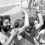 "In this July 2, 1970 file photo, guitarist Jerry Garcia, of the band ""The Grateful Dead,"" left, is joined by Delaney Bramlett, right, in Calgary, Canada, during the legendary ""Festival Express,"" also known as the Transcontinental Pop Festival. Bramlett, who penned classic rock songs such as ""Let it Rain"" and worked with musicians George Harrison and Eric Clapton, died Saturday Dec. 27, 2008 in Los Angeles. He was 69."