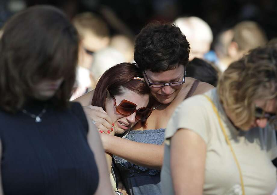 Friends of Alina Bigjohny comfort each other during a memorial service at the Indiana State Fair in Indianapolis, Monday, Aug. 15, 2011. The service was held for those killed in a weekend stage collapse at the fair. (AP Photo/Darron Cummings) Ran on: 08-16-2011 Friends of Alina Bigjohny comfort each other during a memorial service at the Indiana State Fair. Ran on: 08-16-2011 Friends of Alina Bigjohny comfort each other during a memorial service at the Indiana State Fair. Photo: Darron Cummings, AP