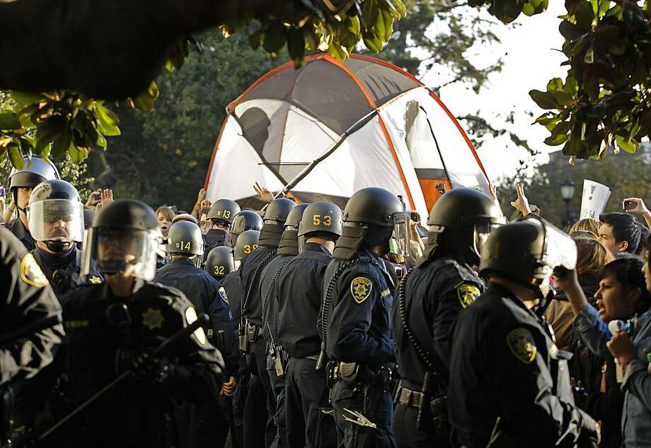 "A tent is raised and returned to a grassy area by student activists in front of Sproul Hall on the University of California at Berkeley campus as police in riot gear retreat Wednesday, Nov. 9, 2011, in Berkeley, Calif. Students attempted to set up an ""Occupy Cal"" camp on campus despite official warnings that such encampments are not allowed. These activists joined students across California in calling to make banks pay to end cuts to higher education. (AP Photo/Ben Margot)  Ran on: 11-11-2011 Photo caption Dummy text goes here. Dummy text goes here. Dummy text goes here. Dummy text goes here. Dummy text goes here. Dummy text goes here. Dummy text goes here. Dummy text goes here.###Photo: letters11_occupy_UC_PH1320710400AP###Live Caption:A tent is raised and returned to a grassy area by student activists in front of Sproul Hall on the University of California at Berkeley campus as police in riot gear retreat Wednesday, Nov. 9, 2011, in Berkeley, Calif. Students attempted to set up an ""Occupy Cal"" camp on campus despite official warnings that such encampments are not allowed. These activists joined students across California in calling to make banks pay to end cuts to higher education.###Caption History:A tent is raised and returned to a grassy area by student activists in front of Sproul Hall on the University of California at Berkeley campus as police in riot gear retreat Wednesday, Nov. 9, 2011, in Berkeley, Calif. Students attempted to set up an ""Occupy Cal"" camp on campus despite official warnings that such encampments are not allowed. These activists joined students across California in calling to make banks pay to end cuts to higher education. (AP Photo-Ben Margot)###Notes:University of California Activists###Special Instructions: Photo: Ben Margot, AP"