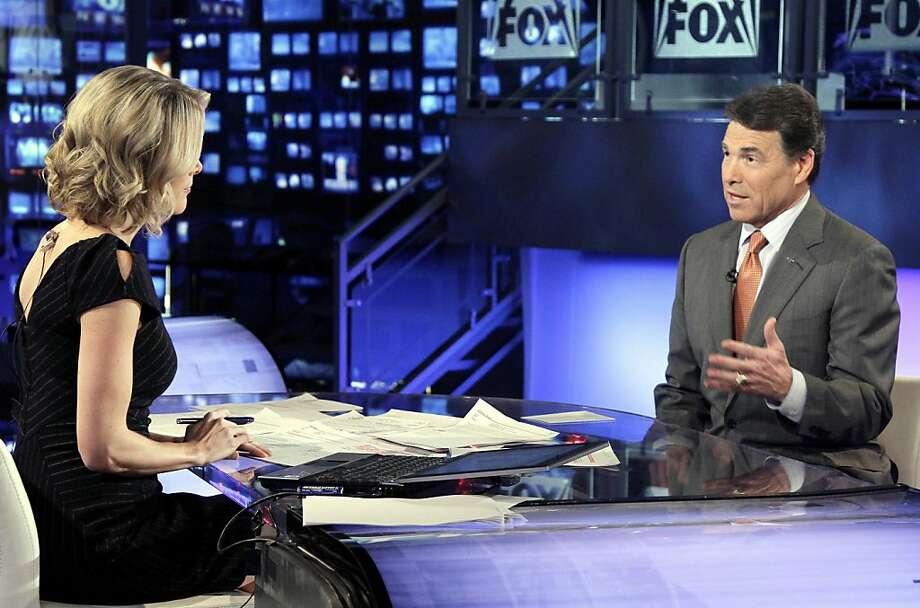 """Republican presidential candidate, Texas Gov. Rick Perry is interviewed by Megyn Kelly during """"America Live"""" on the Fox News Channel in New York, Thursday, Nov. 10, 2011. Perry rearranged his schedule Thursday to try to mitigate a disastrous debate moment, in which he could not remember the third federal agency he has vowed to abolish. Perry canceled a Tennessee fundraiser to appear on several TV networks and the David Letterman show, pledging to stay in the race. (AP Photo/Richard Drew) Photo: Richard Drew, AP"""