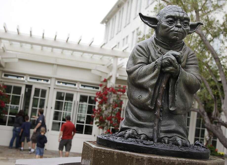 In this Aug. 2, 2011 photo, a life-sized replica of Yoda, George Lucas' master of the Force, is shown at Lucasfilm Ltd. production studios in San Francisco. The production studio is one of many special sites visited by fans. (AP Photo/Paul Sakuma) Photo: Paul Sakuma, AP