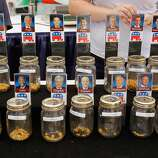 DES MOINES, IA - AUGUST 11:  Voters put corn kernals into jars with their favorite Republican presidential candidates on the first day of the Iowa State Fair August 11, 2011 in Des Moines, Iowa. The candidates, including Mitt Romney, John Huntsman and Newt Gingrich, visited the fair ahead of Saturday's Iowa Straw Poll to greet voters and engage in traditional Iowa campaigning rituals.  (Photo by Chip Somodevilla/Getty Images) *** BESTPIX ***