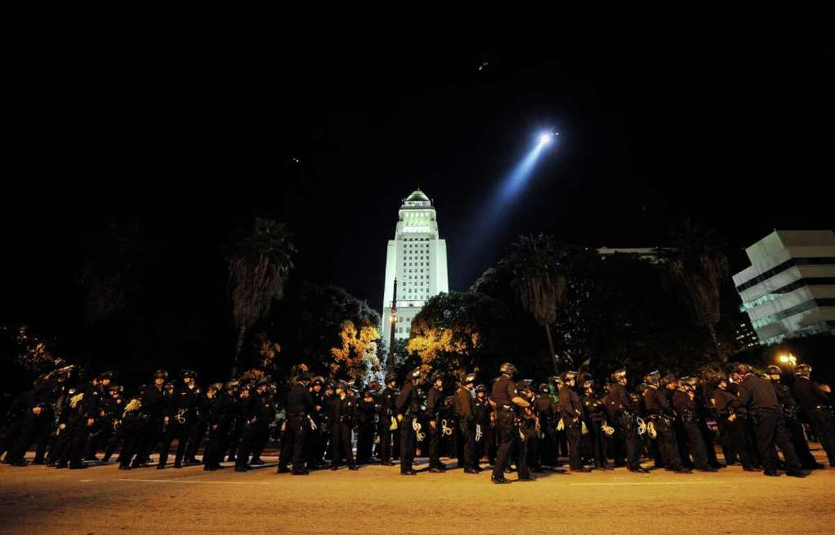 LOS ANGELES, CA - NOVEMBER 30: Hundreds of Los Angeles Police Department officers wait to walk into the Occupy Los Angeles protest encampment following a raid by LAPD on November 30, 2011 in Los Angeles, California. Protesters have remained on the City Hall lawn despite a deadline, set by Los Angeles Mayor Antonio Villaraigosa, to dismantle their campsite and leave the park which the city declared closed as of 12:01 am November 28th. (Photo by Kevork Djansezian/Getty Images)