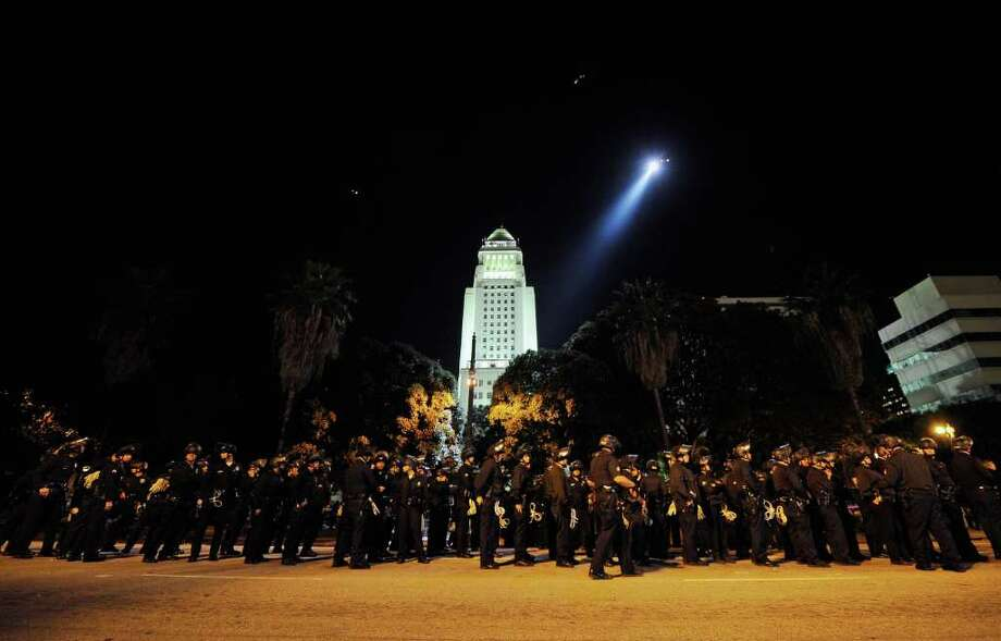 LOS ANGELES, CA - NOVEMBER 30:  Hundreds of Los Angeles Police Department officers wait to walk into the Occupy Los Angeles protest encampment following a raid by LAPD on November 30, 2011 in Los Angeles, California. Protesters have remained on the City Hall lawn despite a deadline, set by Los Angeles Mayor Antonio Villaraigosa, to dismantle their campsite and leave the park which the city declared closed as of 12:01 am November 28th. (Photo by Kevork Djansezian/Getty Images) Photo: Kevork Djansezian, Getty / 2011 Getty Images