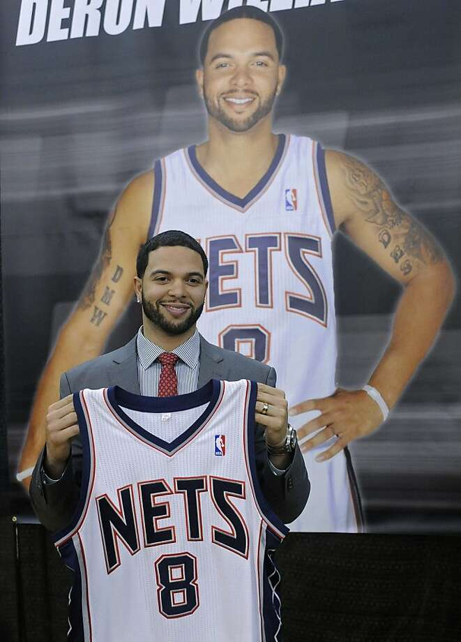 FILE - This Feb. 24, 2011, file photo shows New Jersey Nets' Deron Williams posing in front of his poster at a news conference,  in East Rutherford, N.J. The Turkish team Besiktas says it is close to reaching a deal with NBA All-Star guard Deron Williams.The New Jersey Nets say they can't comment because of the lockout. Photo: Bill Kostroun, AP