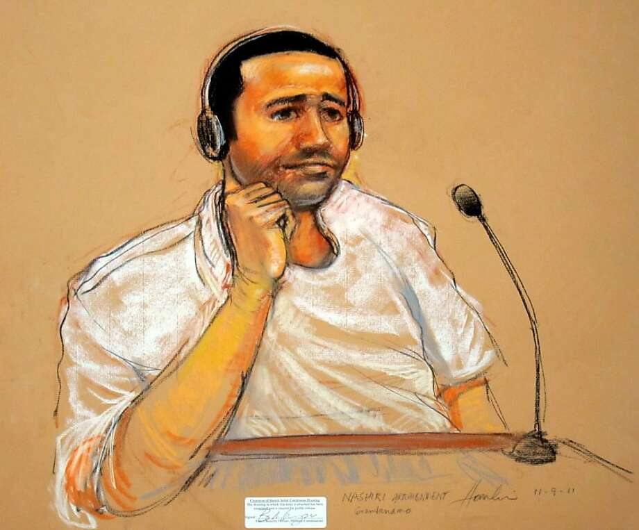 This November 9, 2011 courtroom sketch by Janet Hamlin, shows terror suspect Abd al-Rahim al-Nashiri, 46, who was arraigned at Wednesday's hearing on charges related to the 2000 bombing of the USS Cole in Yemen. Nashiri wore prison clothes for his first public appearance since his 2002 capture. His hair was short and he was unshaven, but he was neither handcuffed nor in ankle chains at his lawyer's request, and smiled several times at the judge. US officials at the Guantanamo Bay Naval base in southeastern Cuba, where the trial is being held, are walking a tightrope as they balance the public's right to an open society with a free flow of information, with the need to ensure that US security interests are paramount and nothing of a sensitive nature is revealed at trial.    AFP PHOTO / JANET HAMLIN (Photo credit should read JANET HAMLIN/AFP/Getty Images) Photo: Janet Hamlin, AFP/Getty Images
