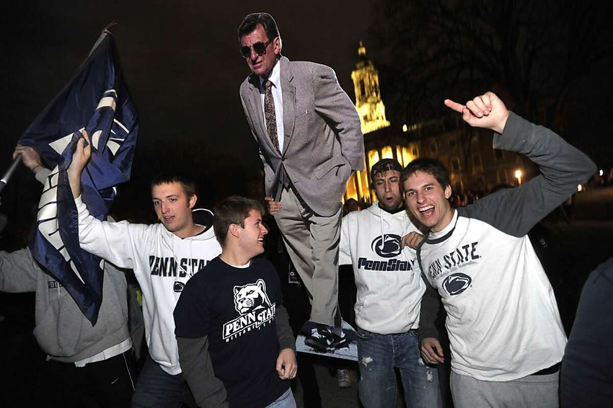 Penn State students carry a Joe Paterno cutout as they pour into the streets of downtown State College, Pennsylvania, on Wednesday, November 9, 2011, after the Penn State Board of Trustees announces the firing of University President Graham Spanier and head football coach Joe Paterno. Both men were fired surrounding the Jerry Sandusky sex abuse scandal. (Nabil K. Mark/Centre Daily Times/MCT)