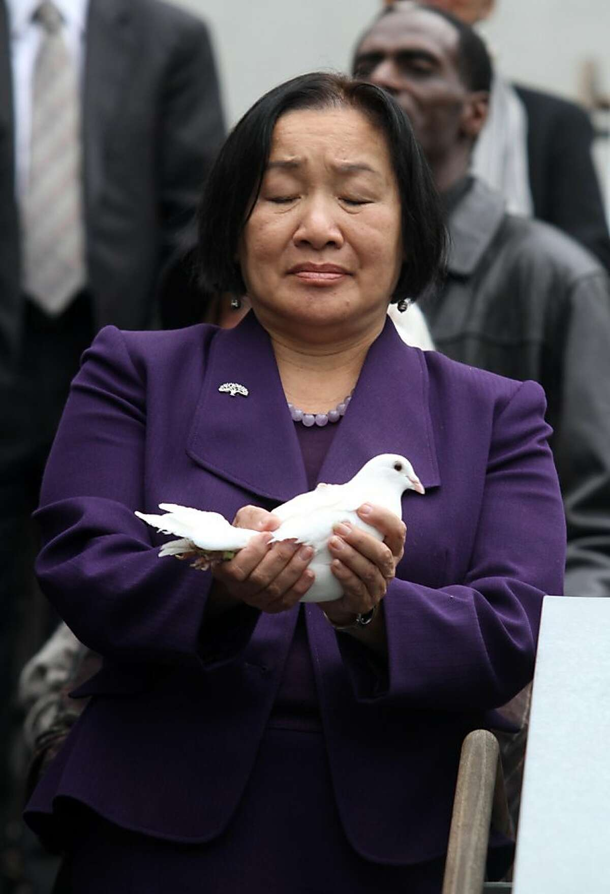 Mayor Jean Quan holds a dove to release at the Northern California Interreligious Conference on Friday, Nov. 11, 2011 in Oakland Calif.