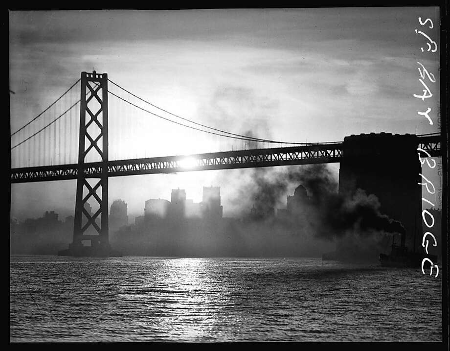 A ship passes beneath the Bay Bridge in 1936. Photo: The Chronicle