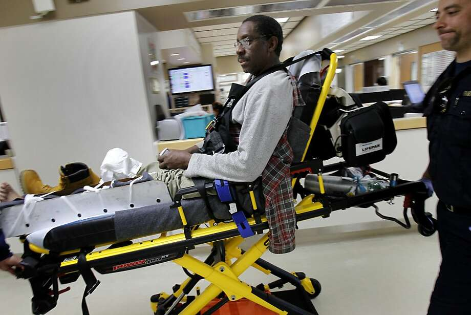 Michael Chatman gets wheeled to a room in the Emergency department.  He is suffering from a construction injury and appreciates the care he gets at Doctors Medical Center. Doctors Medical Center in San Pablo, Calif. may have to close its emergency department if voters don't approve a parcel tax measure.  Emergency patients would have to travel a great distance to receive care if the facility closed. Photo: Brant Ward, The Chronicle