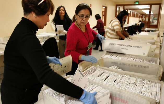 Mila Caguioa, (left) Nina Kung, (background) and Maria Miranda, (center) process the envelopes from mail in ballots from yesterday's election, at City Hall in the Department of Elections office, on Wednesday November 09, 2011, in San Francisco, Ca. Photo: Michael Macor, The Chronicle