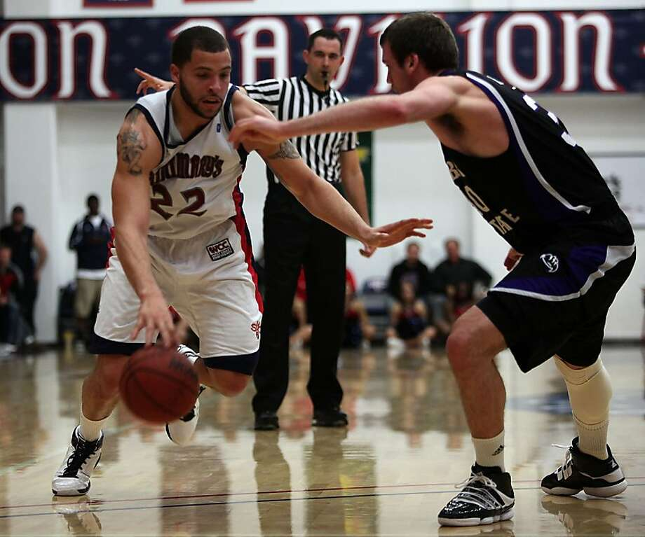 Saint Mary's College vs. Weber State in the NCCA tournament  in Moraga, Calif., as high scorer Rob Jones passes  Weber's Darin Mahoney during the first period on Friday, March 11, 2011. Photo: Liz Hafalia, The Chronicle
