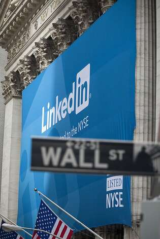 A LinkedIn Corp. banner hangs on the front of the New York Stock Exchange in New York, U.S., on Thursday, May 19, 2011. LinkedIn Corp., the largest professional-networking website, more than doubled in the first day of trading after its initial public offering. Photographer: Michael Nagle/Bloomberg  Ran on: 06-09-2011 LinkedIn used the &quo;low-float&quo; IPO approach.  Ran on: 06-30-2011 LinkedIn, whose banner hangs on Wall Street its first  trading day, gets raves from bankers who took it public. Photo: Michael Nagle, Bloomberg