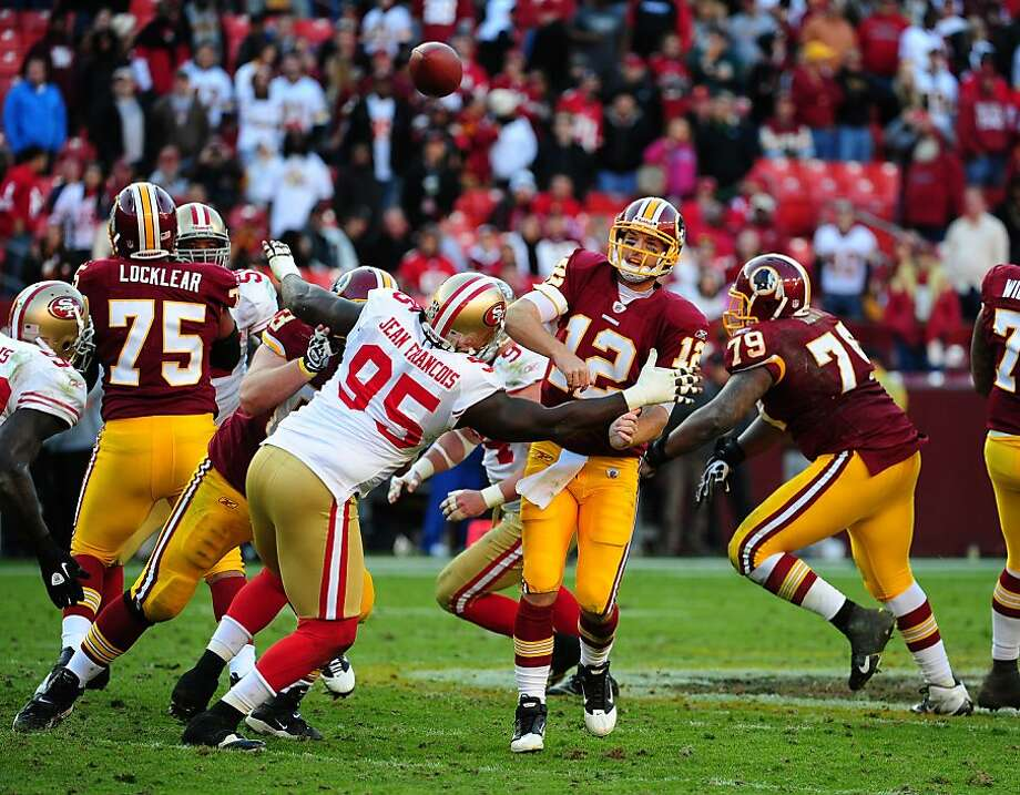 LANDOVER, MD - NOVEMBER 6: John Beck #12 of the Washington Redskins passes despite pressure by Ricky Jean Francois #95 of the San Francisco 49ers at FedEx Field on November 6, 2011 in Landover, Maryland. (Photo by Scott Cunningham/Getty Images) Photo: Scott Cunningham, Getty Images