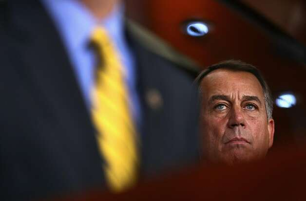 WASHINGTON, DC - AUGUST 01:  U.S. Speaker of the House John Boehner (R-OH) listens to a question during a news conference on the debt limit impasse at the U.S. Capitol on August 1, 2011 in Washington, United States. The House of Representatives and the U.S. Senate is expected to vote today on an agreement to extend the federal debt limit and enact spending cuts. Photo: Win McNamee, Getty Images