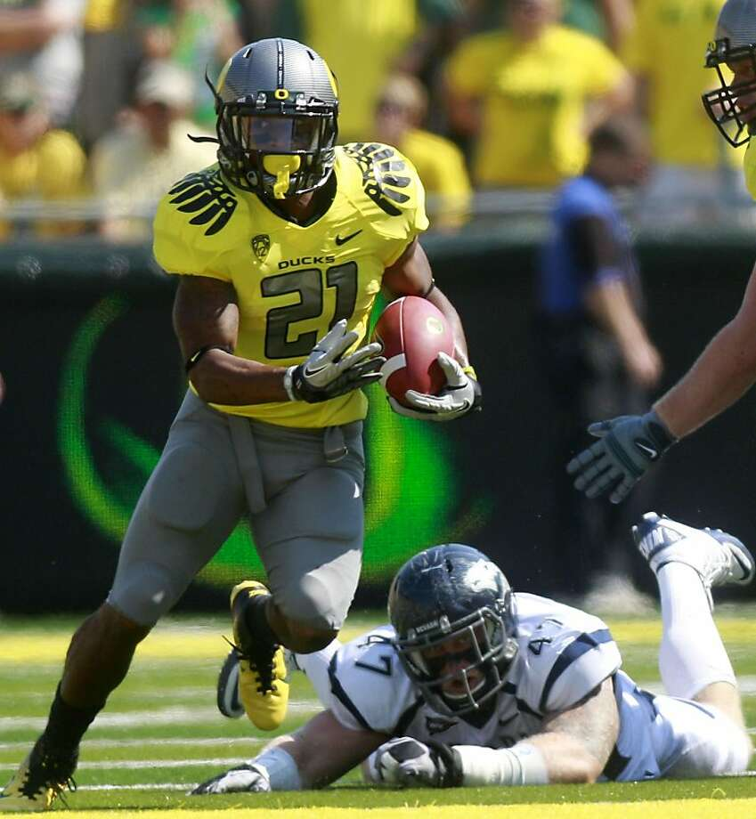 FILE - In this Sept. 10, 2011, file photo, Oregon's LaMichael James (21) runs away as Nevada's Brett Roy (47) falls during the first quarter of an NCAA college football game in Eugene, Ore. James simply knows that Stanford's rushing defense is good. Beyond that, he's not going to analyze it too much. The No. 6 Ducks visit the No. 3 Cardinal on Saturday in a game that will likely decide the Pac-12 North's representative in the inaugural league championship game. At season's end, the game could even have greater implications. (AP Photo/Rick Bowmer, File)  Ran on: 11-12-2011 LaMichael James: 257 yards rushing vs. Stanford in 2010. Ran on: 11-12-2011 LaMichael James: 257 yards rushing vs. Stanford in 2010. Photo: Rick Bowmer, AP