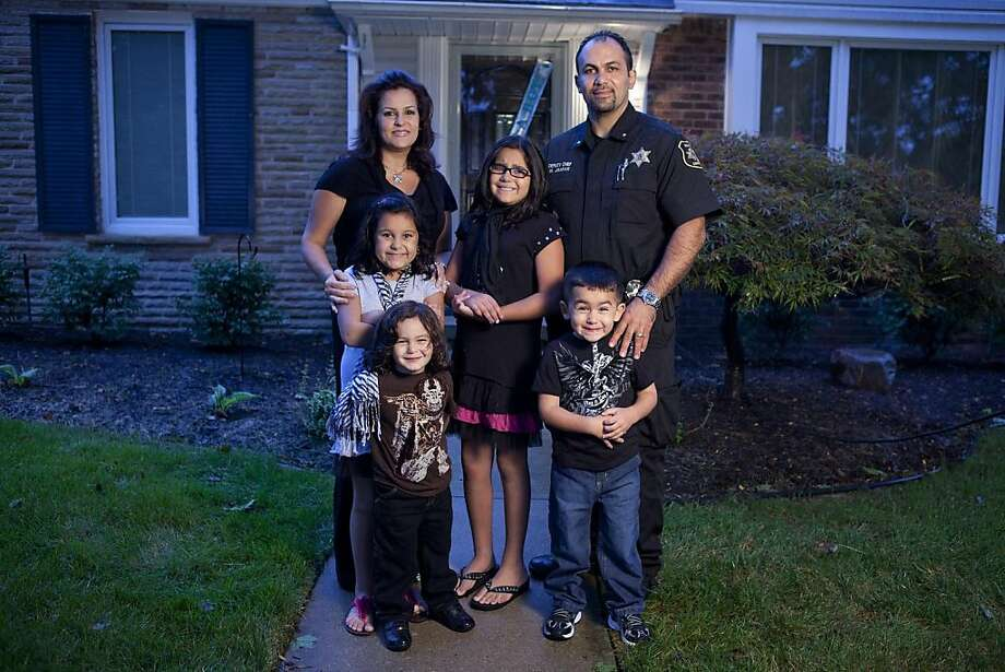 "Mike Jaafar, back right, and his family will appear in, ""All American Muslim,"" on TLC.  Ran on: 11-12-2011 Mike Jaafar and his wife and children are among five families profiled in the documentary series &quo;All-American Muslim.&quo; Photo: Adam Rose, TLC"