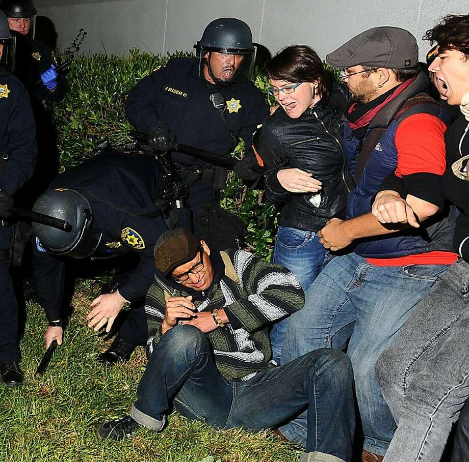 Young Occupy Cal protesters clash with police officers on Wednesday, Nov. 9, 2011, in Berkeley, Calif. Photo: Noah Berger, Special To The Chronicle