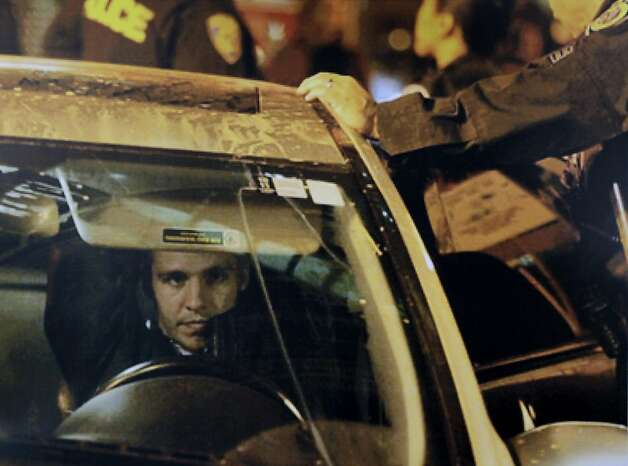 A photograph released by attorneys show an unidentified driver after he allegedly ran down and injured two Occupy Oakland protesters, Lance Laverdure and Margaret So, at last week's general strike in Oakland, Calif. Photo: Farrise Law Firm