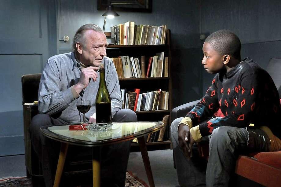 Marcel Marx (AndrŽ Wilms) and Idrissa (Blondin Miguel) in Aki KaurismŠki's LE HAVRE. Photo: Marja-Leena Hukkanen, Janus Films
