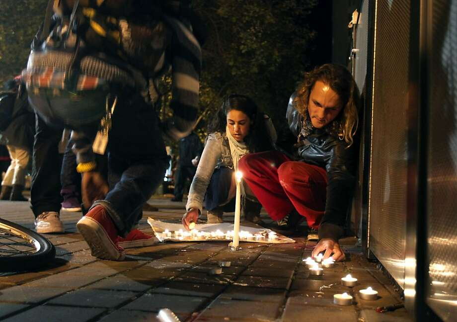 Supporters of Occupy Oakland light candles for a shooting victim at the southeast corner of Frank Ogawa Place Thursday November 10, 2011 Photo: Lance Iversen, The Chronicle
