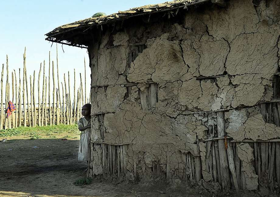 This picture taken on September 20, 2011 shows a young Maasai girl standing outside a dwelling at a traditional village near Narok, some 170 kms west of Nairobi,  where the culture of female-circumcisiion is still practiced despite having been outlawed. A small church house shelters around a dozen Maasai girls escaping female circumcision and early marriage; age-old customs of the Kenyan tribe now being frayed by health risks and new laws.  AFP PHOTO/Tony KARUMBA (Photo credit should read TONY KARUMBA/AFP/Getty Images) Photo: Tony Karumba, AFP/Getty Images