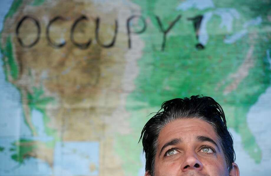 Occupy Oakland camper Chris Avilla discusses the interplay between the Occupy movement and factions that call for violence and destruction on Tuesday, Nov. 8, 2011, in Oakland, Calif. Photo: Noah Berger, Special To The Chronicle
