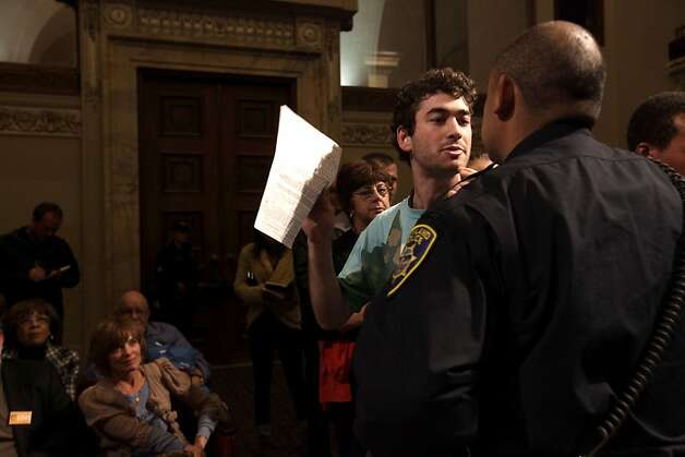 Protester Elon Ullman, 22, is escorted by police after he spoke during an open forum, Thursday Nov. 3, 2011, at a special meeting with the City Council and Mayor about Occupy Oakland in Oakland, Calif. Photo: Lacy Atkins, The Chronicle