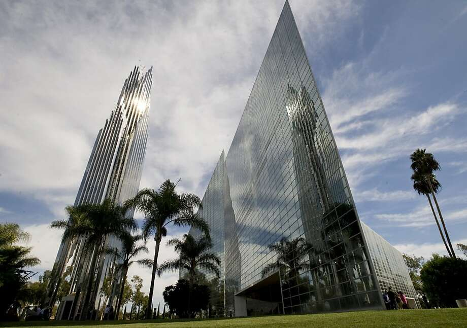 FILE - This Oct. 24, 2010 file photo shows the sun reflecting off the Crystal Cathedral in Garden Grove, Calif.The bidding war has intensified for the site of Orange County's famed Crystal Cathedral Ministries, which filed for Chapter 11 bankruptcy protection last year. (AP Photo/Orange County Register, Ana Venegas, File)   MAGS OUT; LOS ANGELES TIMES OUT  Ran on: 07-07-2011 Crystal Cathedral in Garden Grove has a number of potential purchasers besides the diocese. Ran on: 07-07-2011 Crystal Cathedral in Garden Grove has a number of potential purchasers besides the diocese. Photo: Ana Venegas, AP