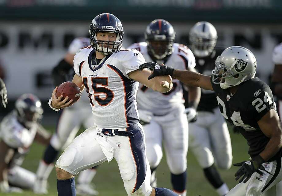 Denver Broncos quarterback Tim Tebow (15) runs against Oakland Raiders safety Michael Huff (24) in the third quarter of an NFL football game in Oakland, Calif., Sunday, Nov. 6, 2011. (AP Photo/Ben Margot) Photo: Ben Margot, AP