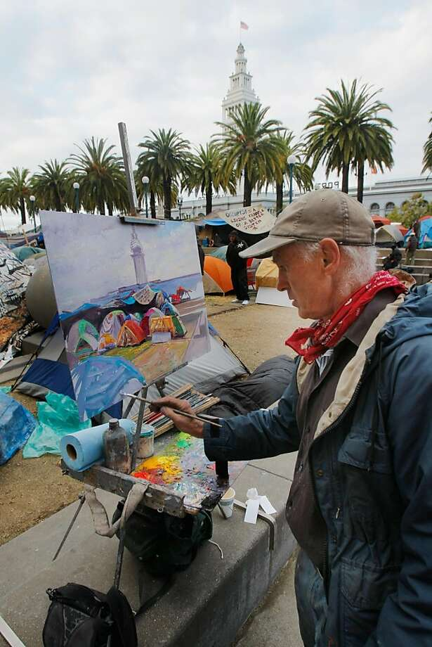 Anthony Holdsworth paints the Occupy San Francisco camp in Justin Herman Plaza in San Francisco, Calif., on Sunday, Nov. 6, 2011. Photo: Thomas Webb, The Chronicle