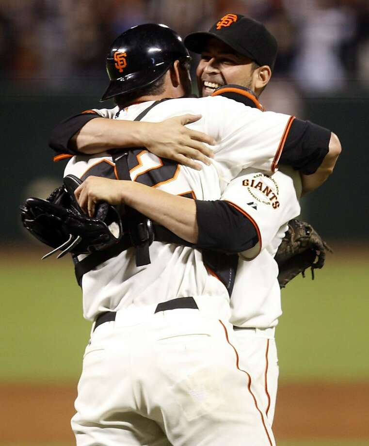 San Diego Padres vs. San Francisco Giants--Jonathan Sanchez hugs Eli Whiteside after the game as he pitches a no-hitter at AT&T Park in San Francisco, Calif., on Friday, July 10, 2009.   Ran on: 07-11-2009 Photo caption Dummy text goes here. Dummy text goes here. Dummy text goes here. Dummy text goes here. Dummy text goes here. Dummy text goes here. Dummy text goes here. Dummy text goes here. Ran on: 07-11-2009 Photo caption Dummy text goes here. Dummy text goes here. Dummy text goes here. Dummy text goes here. Dummy text goes here. Dummy text goes here. Dummy text goes here. Dummy text goes here. Photo: Liz Hafalia, The Chronicle