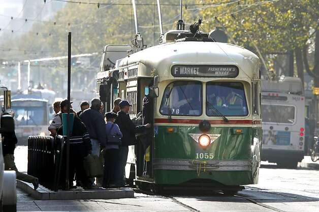 A railway car makes a stop along Market Street on Thursday November 10, 2011 in San Francisco, Ca. The Municipal Transportation Agency is facing a $34 million deficit for next year and a $46 million deificit for the following year. Ideas to help erase that gap include charging riders who pay cash fares an extra 25 cents, and another 25 cents on top of that if they use a transfer. Also being considered is making drivers pay $3 more for parking fines and having parking meters fed on Sundays and later into the evenings. Photo: Michael Macor, The Chronicle