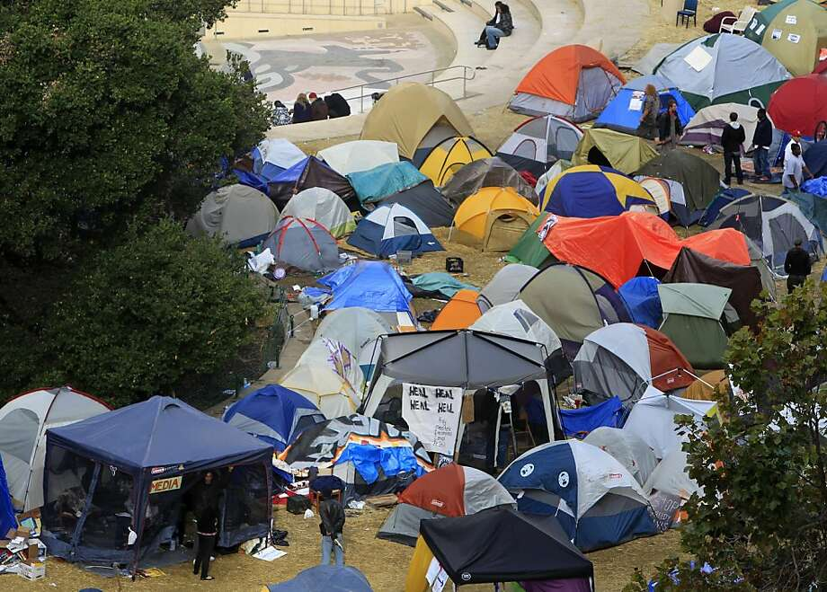 Campers in the Occupy Oakland encampment emerge from their tents after a night of violence in Oakland, Calif. on Thursday, Nov. 3, 2011. Photo: Paul Chinn, The Chronicle