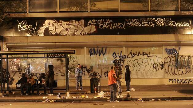 Graffiti covers a building on Broadway following an Occupy Oakland protest on Thursday, Nov. 3, 2011, in Oakland, Calif. After a mainly peaceful day-long protest by thousands of anti-Wall Street demonstrators, several hundred rallied through the night with a few painting graffiti, breaking windows and setting fire to garbage cans. (AP Photo/Noah Berger) Photo: Noah Berger, AP