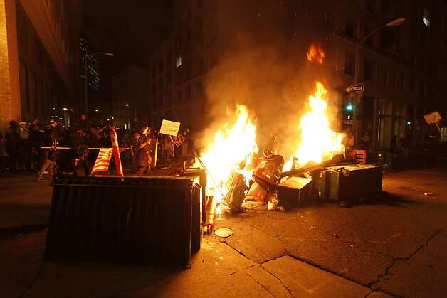 The Occupy Oakland protesters set a fire on trash to make a barricade as the police officers form a line to disperse the protesters on November 3, 2011 in Oakland, California. AFP Photo/ Kimihiro Hoshino (Photo credit should read KIMIHIRO HOSHINO/AFP/Getty Images) Photo: Kimihiro Hoshino, AFP/Getty Images