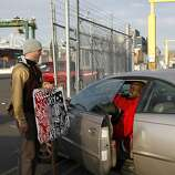 An Oakland dock worker (right) expresses his frustration with a protestor attempting to close an entrance gate in the port early Thursday, November 3, 2011 in Oakland, Calif.