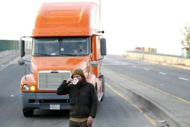 A protestor takes a sip from his mug after forcing a truck driver to turn around at the barricade at 3rd Street and Adeline early Thursday, November 3, 2011 in Oakland, Calif. Photo: Beck Diefenbach, Special To The Chronicle