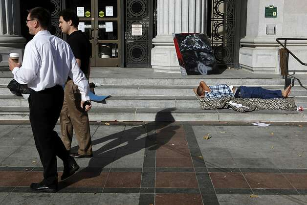 A protestor sleeps on the steps of Oakland City Hall on Thursday, November 3, 2011 in Oakland, Calif. Photo: Beck Diefenbach, Special To The Chronicle