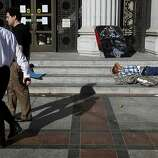 A protestor sleeps on the steps of Oakland City Hall on Thursday, November 3, 2011 in Oakland, Calif.